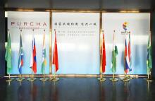 【匠南广告】国际公司企业大堂背景墙设计、展架设计